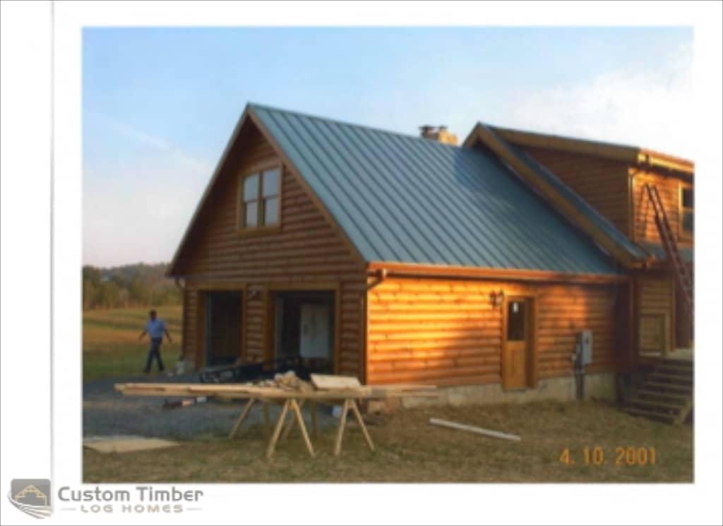 Log home exterior pictures custom timber log homes for Log home garages