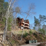 log home on hill overlooking view