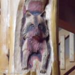 Raccoon Carving in Log Home