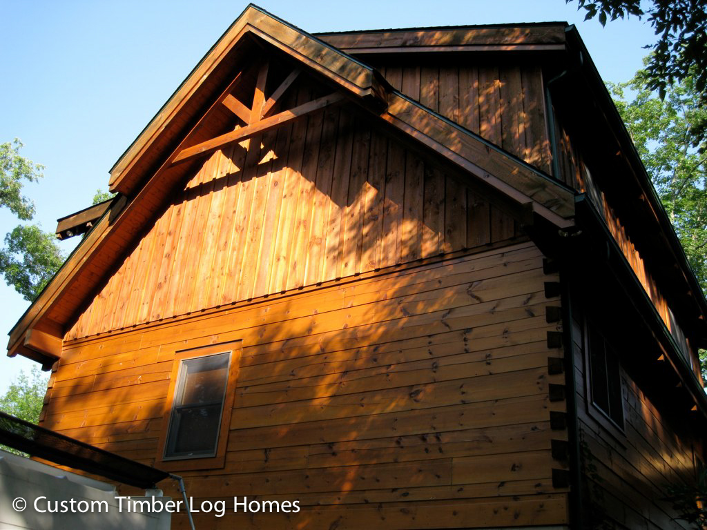 Board and batten siding on gable custom timber log homes for Board and batten homes