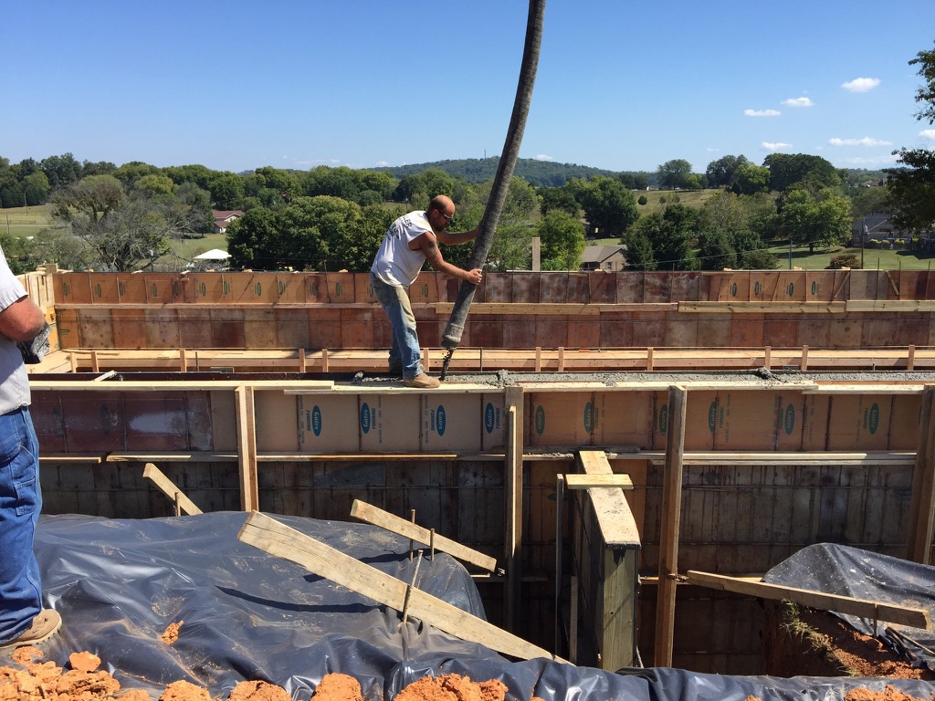 Concrete walls being poured - pumped